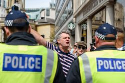Right wing fascist supporter shouts at polic shouting